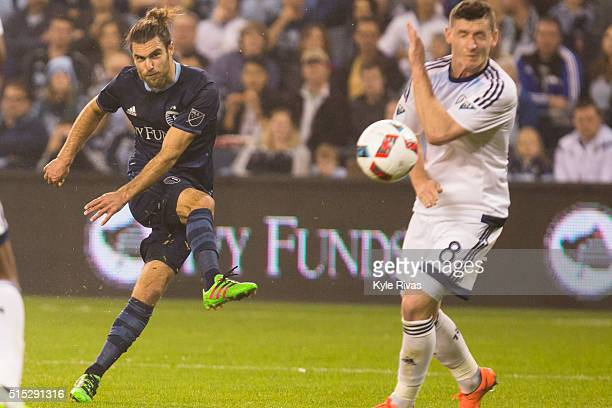 Graham Zusi of Sporting Kansas City takes a shot on goal past Fraser Aird of Vancouver Whitecaps in the second half on March 12 2016 at Children's...