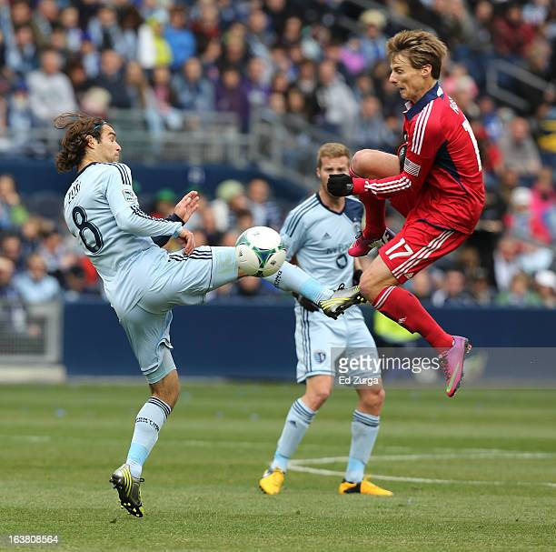 Graham Zusi of Sporting Kansas City tries to gain control of the ball against Chris Rolfe of Chicago Fire in the first half at Sporting Park on March...