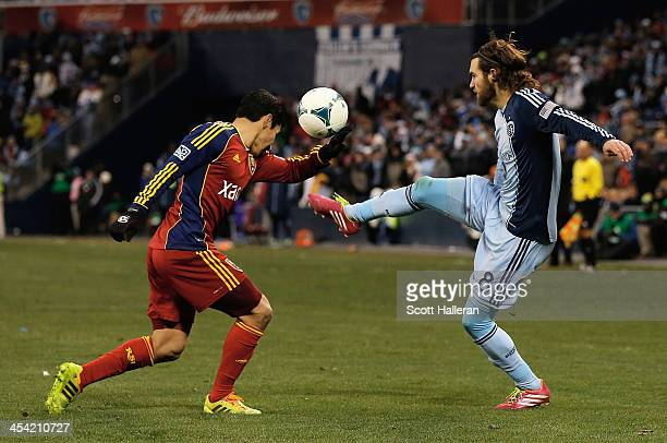 Graham Zusi of Sporting KC works the ball against Tony Beltran of Real Salt Lake in the second half of the 2013 MLS Cup at Sporting Park on December...