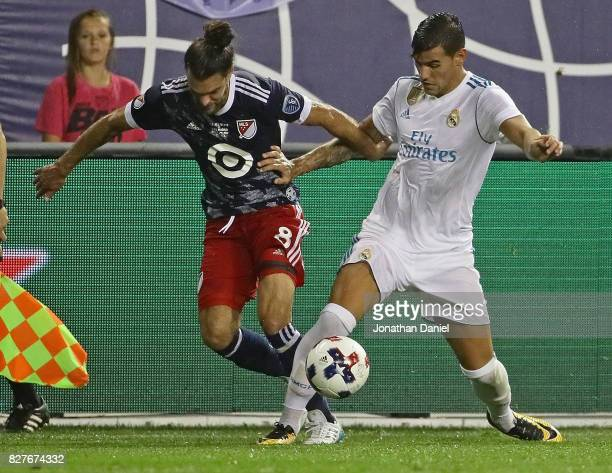Graham Zusi of the MLS AllStars battles for the ball with Theo Hernandez of Real Madrid during the 2017 MLS All Star Game at Soldier Field on August...