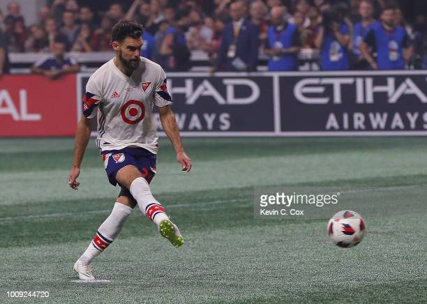 Graham Zusi of the MLS All-Stars scores the first penality kick against Juventus during the 2018 MLS All-Star Game at Mercedes-Benz Stadium on August...