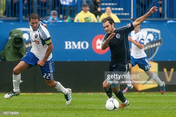 Graham Zusi of the Sporting KC controls the ball against Davy Arnaud during the MLS match against at Saputo Stadium on September 22 2012 in Montreal...