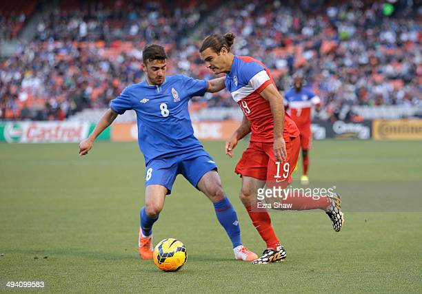 Graham Zusi of the United States and Gara Garayev of Azerbaijan go for the ball during their match at Candlestick Park on May 27 2014 in San...