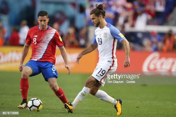 Graham Zusi of the United States challenged by Bryan Oviedo of Costa Rica during the United States Vs Costa Rica CONCACAF International World Cup...