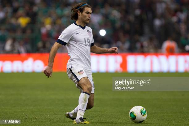 Graham Zusi of the United States drives the ball during a match between Mexico and US as part of FIFA 2014 World Cup Qualifier at The Azteca stadium...