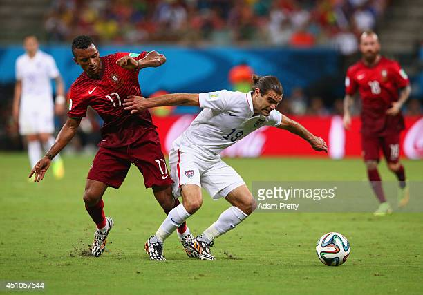 Graham Zusi of the United States fights off Nani of Portugal during the 2014 FIFA World Cup Brazil Group G match between the United States and...