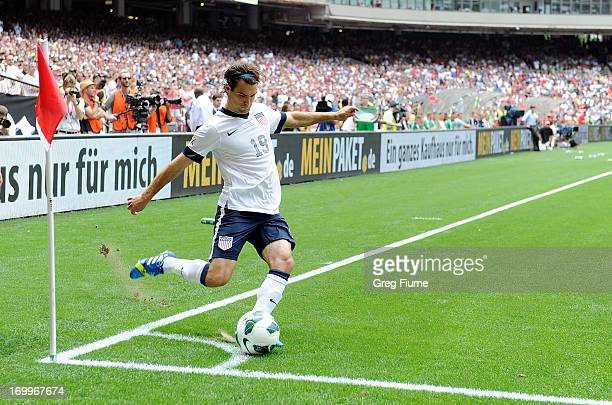 Graham Zusi of the United States Men's National Team takes a corner kick against the Germany Men's National Team in an international friendly at RFK...