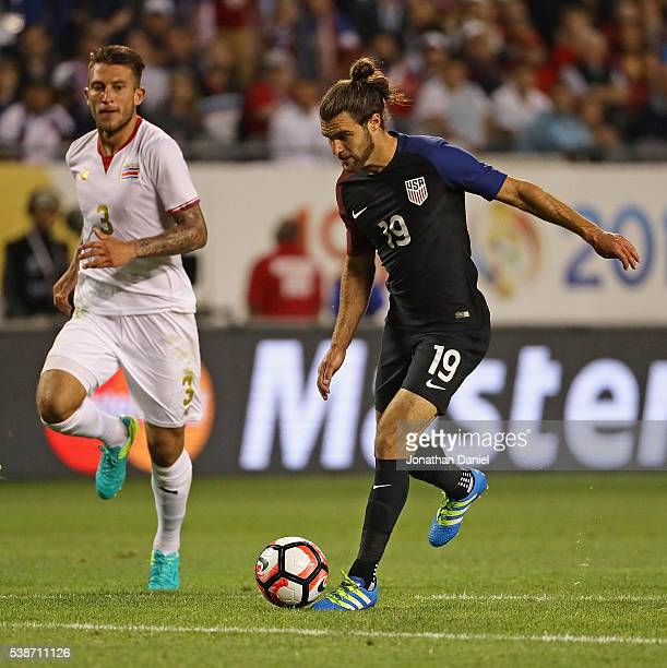 Graham Zusi of the United States moves past Francisco Calvo of Costa Rica on his way to scoring a goal during a match in the 2016 Copa America...