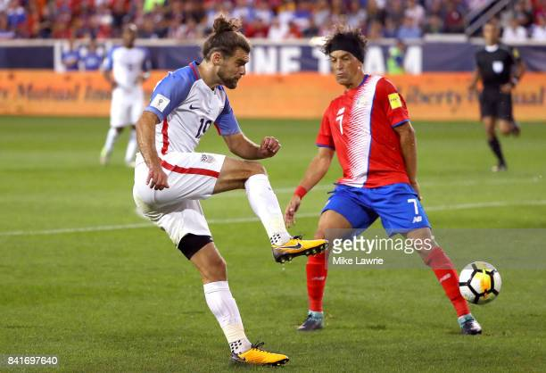 Graham Zusi of the United States shoots against Cristian Bolanos of Costa Rica in the first half during the FIFA 2018 World Cup Qualifier at Red Bull...
