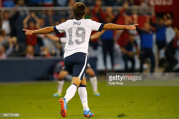 Graham Zusi of the U.S. Men's National Soccer Team celebrates after scoring the first goal of the game against Jamaica midway in the second half at...
