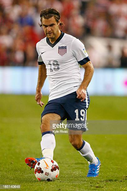 Graham Zusi of the US Men's National Soccer Team passes the ball past the Jamaica defenders early in the second half at Sporting Park on October 11...