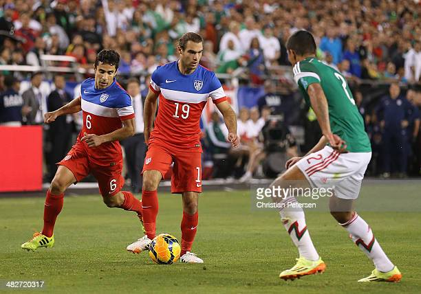 Graham Zusi of USA controls the ball during the International Friendly against Mexico at University of Phoenix Stadium on April 2, 2014 in Glendale,...