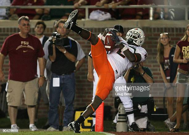 Graig Cooper of the Miami Hurricanes catches a 24yard touchdown pass from in the fourth quarter against the Florida State Seminoles at Doak Campbell...