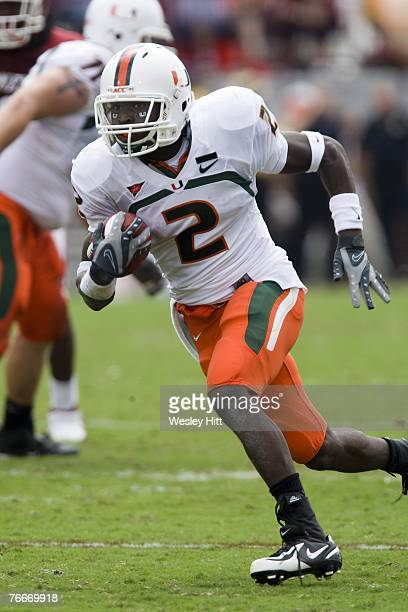 Graig Cooper of the Miami Hurricanes runs with the ball against the Oklahoma Sooners at Gaylord FamilyOklahoma Memorial Stadium on September 8 2007...