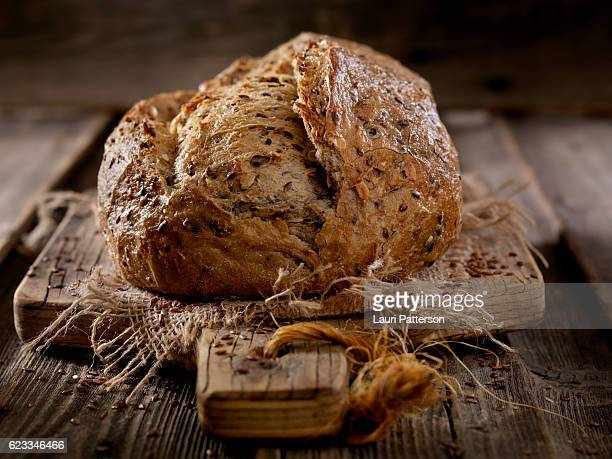 9 grain artisan bread loaf - millet stock pictures, royalty-free photos & images