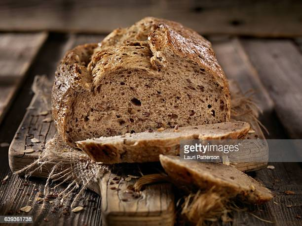 9 grain artisan bread loaf - loaf of bread stock pictures, royalty-free photos & images