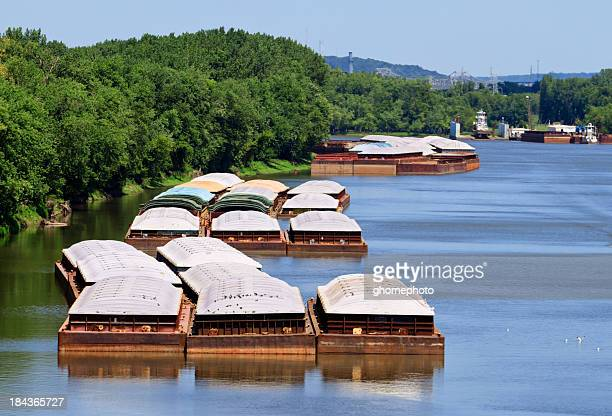 grain barges on the river - barge stock photos and pictures