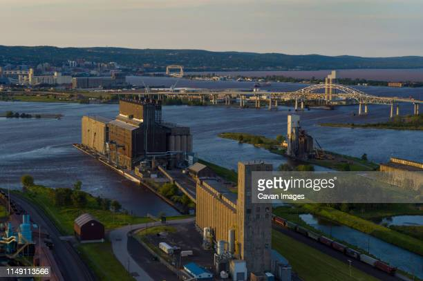 grain elevators, st. louis river estuary from superior, wisconsin - vilas_county,_wisconsin stock pictures, royalty-free photos & images