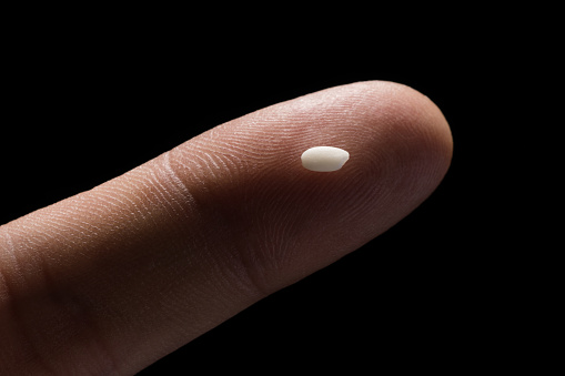 A Grain of Rice On Tip of Finger - gettyimageskorea