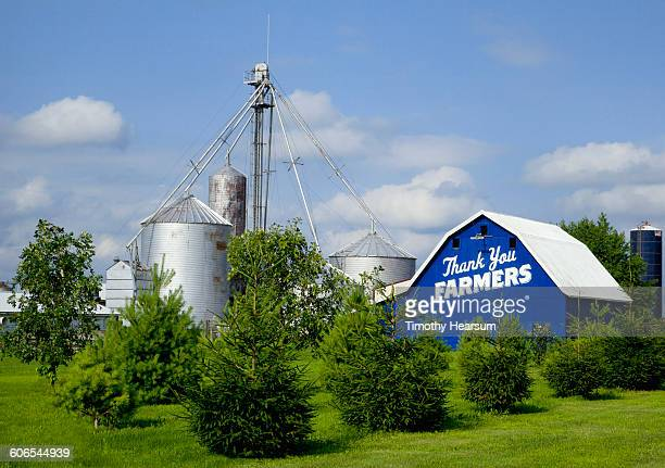 grain silos and blue barn thanking farmers - timothy hearsum stock pictures, royalty-free photos & images