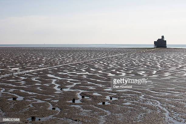 Grain Tower a mid19thcentury gun tower is exposed by the receding tide on the Isle of Grain on August 31 2016 in Isle of Grain England The Isle of...
