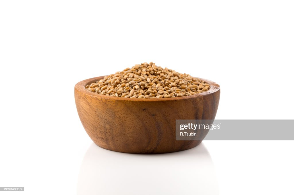 Grain wheat in wooden bowl : Stock Photo