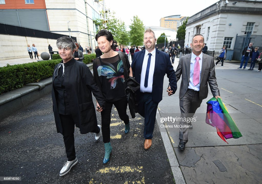 Grainne Close (L) and Shannon Sickles (2nd L) alongside Henry Edmond Kane (3rd L) and Christopher Patrick Flanagan (4th L) at Belfast High Court walk hand in hand after losing their case calling for same-sex marriage to be recognised in Northern Ireland on August 17, 2017 in Belfast, Northern Ireland. The judge dismissed both cases. Same-sex marriage is recognised in the rest of the United Kingdom but not in Northern Ireland were the largest political party, the DUP has blocked proposed legislation. Shannon Sickles and Grainne Close, the first women to have a civil partnership in the UK and Henry Edmond Kane and Christopher Patrick Flanagan were challenging the NI Assembly's repeated refusal to legislate for same sex marriage.