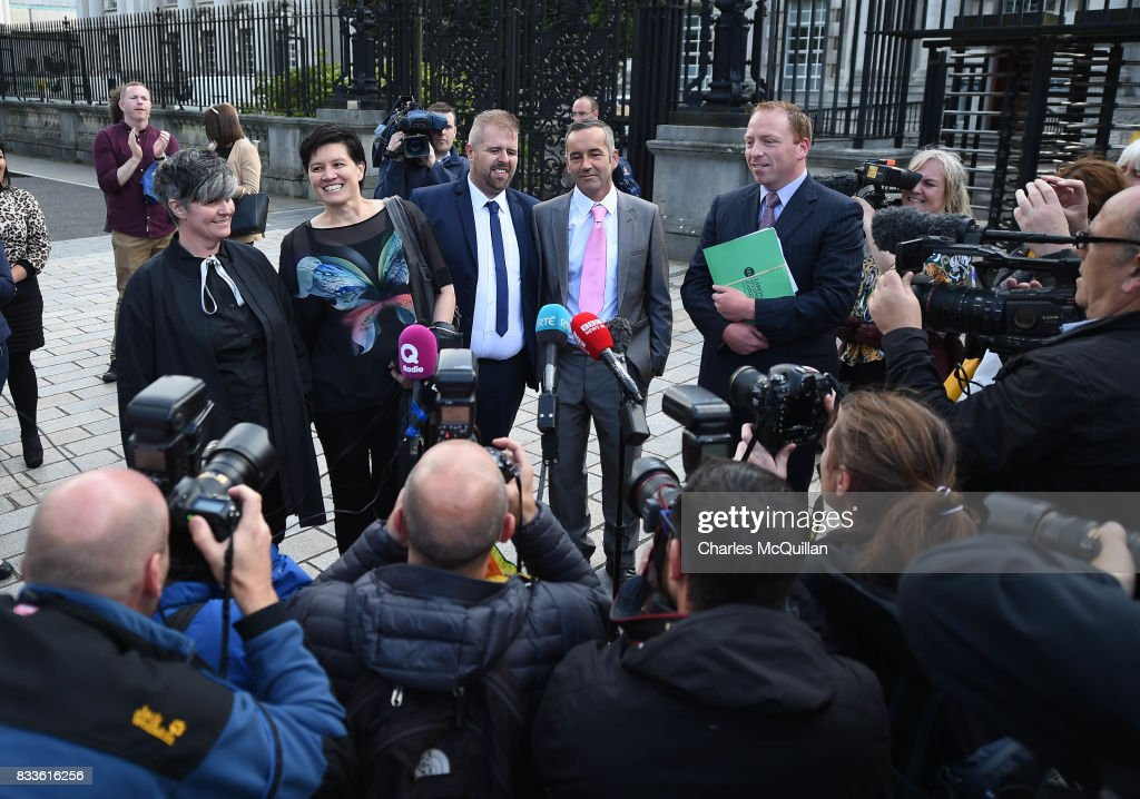 Grainne Close (L) and Shannon Sickles (2nd L) alongside Henry Edmond Kane (3rd L) and Christopher Patrick Flanagan (4th L) at Belfast High Court speak to the media after the ruling on whether to allow same-sex marriage in Northern Ireland on August 17, 2017 in Belfast, Northern Ireland. The judge dismissed both cases. Same-sex marriage is recognised in the rest of the United Kingdom but not in Northern Ireland were the largest political party, the DUP has blocked proposed legislation. Shannon Sickles and Grainne Close, the first women to have a civil partnership in the UK and Henry Edmond Kane and Christopher Patrick Flanagan were challenging the NI Assembly's repeated refusal to legislate for same sex marriage.