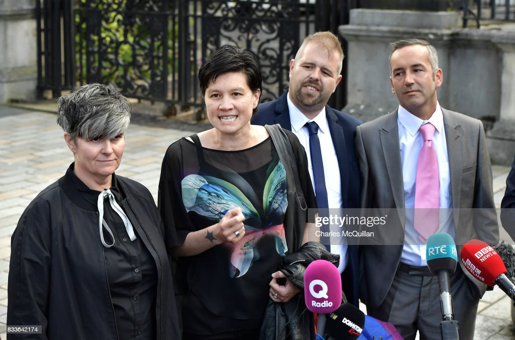 Grainne Close (L) and Shannon Sickles (2nd L) alongside Henry Edmond Kane (2nd R) and Christopher Patrick Flanagan (R) address the media outside Belfast High Court after the ruling on whether to allow same-sex marriage in Northern Ireland on August 17, 2017 in Belfast, Northern Ireland. The judge dismissed both cases. Same-sex marriage is recognised in the rest of the United Kingdom but not in Northern Ireland were the largest political party, the DUP has blocked proposed legislation. Shannon Sickles and Grainne Close, the first women to have a civil partnership in the UK and Henry Edmond Kane and Christopher Patrick Flanagan were challenging the NI Assembly's repeated refusal to legislate for same sex marriage.