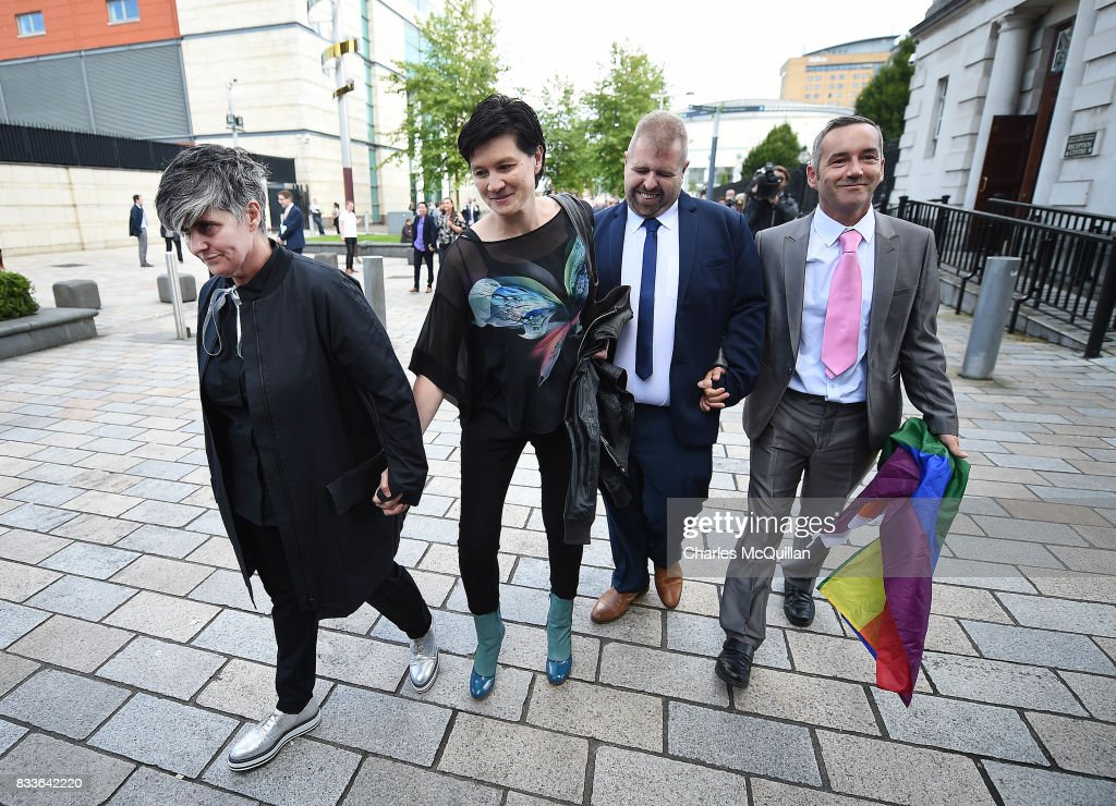 Grainne Close (L) and Shannon Sickles (2nd L) alongside Henry Edmond Kane (2nd R) and Christopher Patrick Flanagan (R) leave Belfast High Court hand in hand after the ruling on whether to allow same-sex marriage in Northern Ireland on August 17, 2017 in Belfast, Northern Ireland. The judge dismissed both cases. Same-sex marriage is recognised in the rest of the United Kingdom but not in Northern Ireland were the largest political party, the DUP has blocked proposed legislation. Shannon Sickles and Grainne Close, the first women to have a civil partnership in the UK and Henry Edmond Kane and Christopher Patrick Flanagan were challenging the NI Assembly's repeated refusal to legislate for same sex marriage.