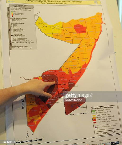 Grainne Moloney chief technical advisor from Food Security and Nutrition Analysis UnitSomalia shows to journalists a handout map by the UN Office for...
