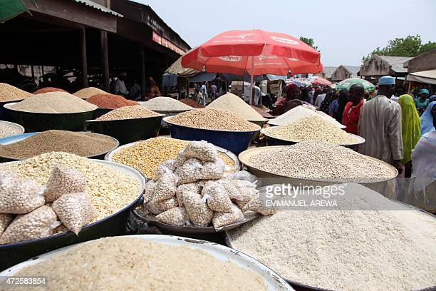 Grains and spices are displayed at a stall in Yola market in Adamawa on May 8 2015 AFP PHOTO/EMMANUEL AREWA