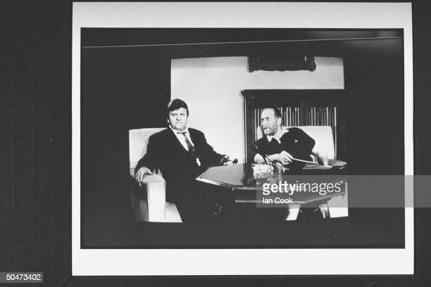 Grainy TV image of former chess champion Bobby Fischer w Yugoslavian entrepreneur chess promoter Jezdimir Vasiljevic as they announce his upcoming $5...