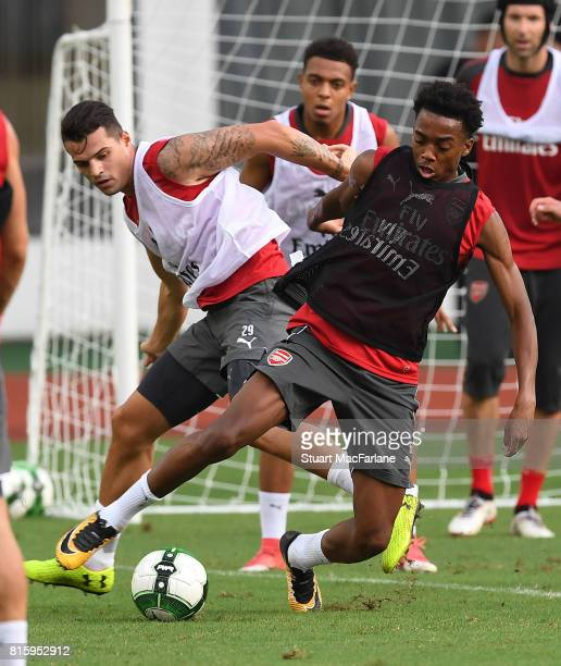 Grait Xhaka and Joe Willock of Arsenal during a training session at the Yuanshen stadium in Shanghi on July 17 2017 in Shanghai China