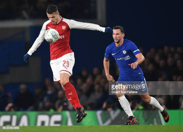 Grait Xhaka of Arsenal breaks past Danny Drinkwater of Chelsea during the Carabao Cup SemiFinal First Leg match between Chelsea and Arsenal at...