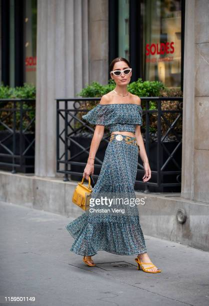 Géraldine Boublil is seen wearing grey off shoulder dress, yellow bag outside Schiaparelli during Paris Fashion Week - Haute Couture Fall/Winter...