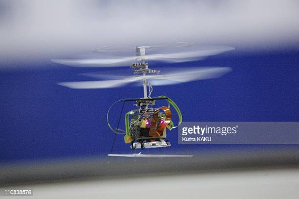 Seiko Epson'S Micro Flying Robot 'IfrIi' Hovers During A Test Flight In Tokyo Japan On August 18 2004 The 123 gram 85 mmtall robot equipped with the...