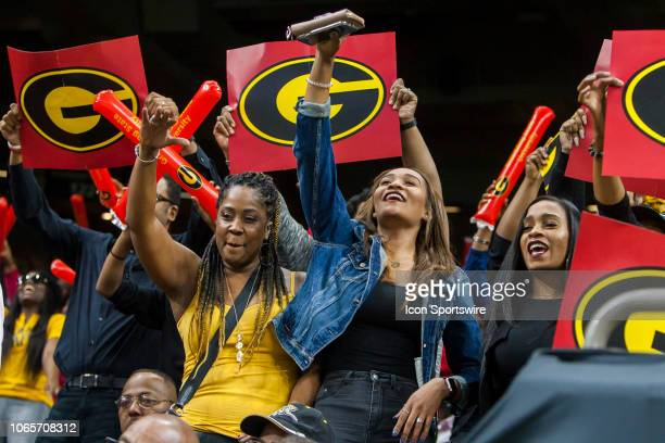 Grambling State fans celebrated after their team's touchdown during the 45th annual State Farm Bayou Classic game between the Southern Jaguars and...
