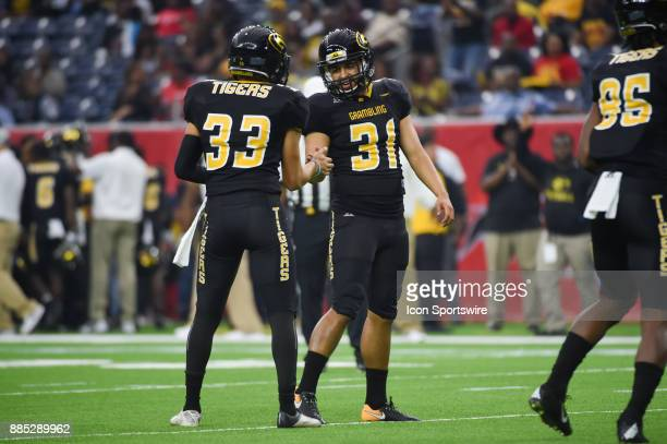 Grambling State Tigers kicker Marc Orozco shakes hands with Grambling State holder Miguel Mendez after a successful PAT during the SWAC Championship...