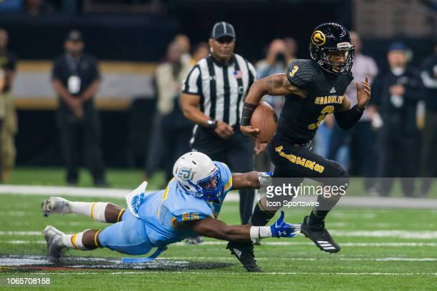 Grambling State Tigers quarterback Charles Wright slips through an tackle during the 45th annual State Farm Bayou Classic game between the Southern...