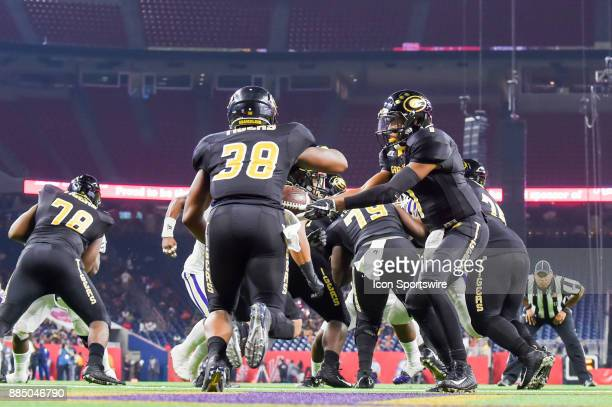 Grambling State Tigers quarterback Devante Kincade hands off to Grambling State Tigers running back Dre' Fusilier in his own end zone during the SWAC...