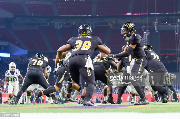 Grambling State Tigers quarterback Devante Kincade hands the ball off to Grambling State Tigers running back Dre' Fusilier deep in his own endzone...