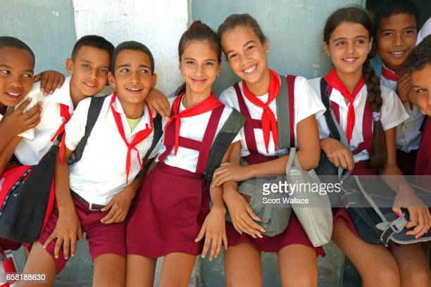 Grammar school students leaving class in the former sugar mill settlement of Pepito Tey Cienfuegos Cuba 21st February 2014