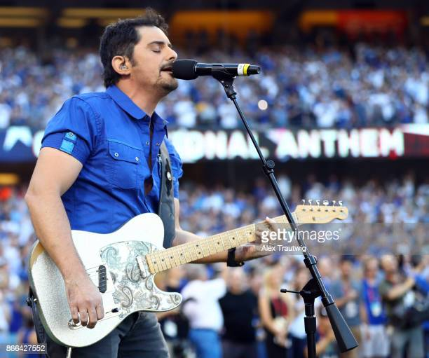Grammy award winning artist Brad Paisley sings the national anthem before Game 2 of the 2017 World Series between the Houston Astros and the Los...