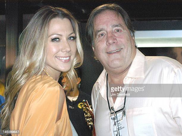 Grammy award winning singer Colbie Callait and her father record producer Ken Callait pose for a portrait at the Anaheim Convention Center during the...