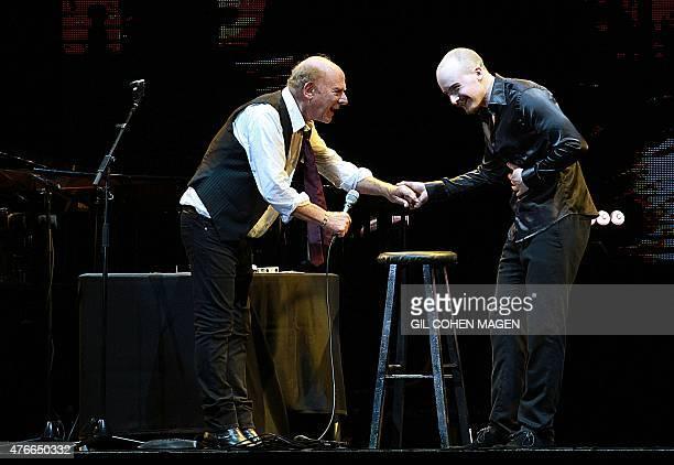 Grammy Awardwinning American singer Art Garfunkel performs with his son James on stage at the Bloomfield Stadium in the Israeli city of Tel Aviv on...