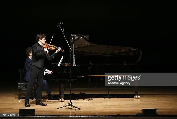 Grammy Awardwinning violinist Joshua Bell perform during a concert at ATO Congresium in Ankara Turkey on May 16 2016