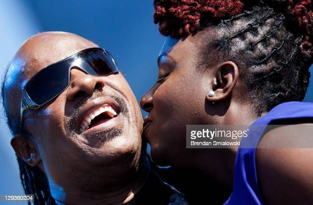 Grammy nominated recording artist Ledisi kisses Stevie Wonder after singing a duet during a dedication ceremony at the Martin Luther King Memorial on...