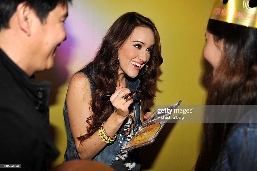 Grammy nominated singer Britt Nicole signs an autograph for a fan at The Roxy Theatre on January 9, 2013 in West Hollywood, California.