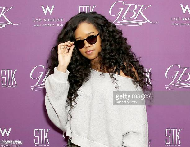 """Grammy nominee H.E.R. Attends the GBK & STK at The """"W"""" Hotel Pre-Grammy Lounge on February 9, 2019 in Los Angeles, California."""